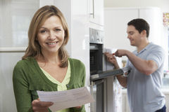 Satisfied Female Customer With Oven Repair Bill Stock Image