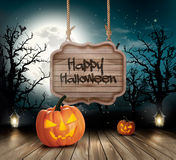 Scary Halloween background with a wooden sign. Royalty Free Stock Image
