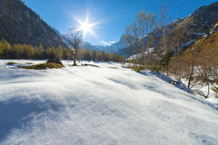 A scenic landscape with snow capped mountains in the late autumn season Stock Photos