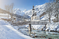 Scenic winter landscape with pilgrimage church in the Alps Royalty Free Stock Photos