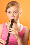 School girl playing the recorder Royalty Free Stock Photography