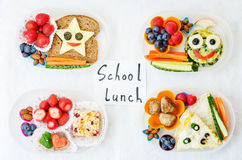 School lunch boxes for kids with food in the form of funny faces Royalty Free Stock Images
