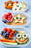 School lunch boxes for kids with food in the form of funny faces Royalty Free Stock Photography