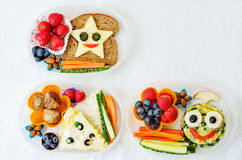 School lunch boxes for kids with food in the form of funny faces Stock Images
