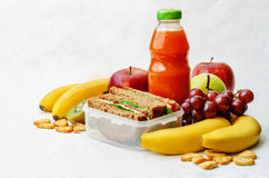 School lunch with a sandwich, fresh fruits, crackers and juice Royalty Free Stock Photo