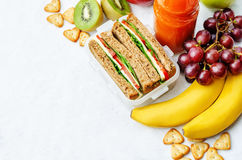 School lunch with a sandwich, fresh fruits, crackers and juice Stock Photography