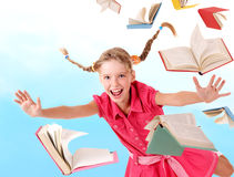Schoolgirl  holding pile of books. Stock Photos