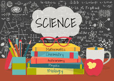 SCIENCE in speech bubbles above science books, pens box,apple and mug with science doodles on chalkboard background Royalty Free Stock Image