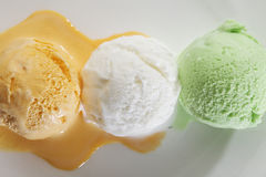 Scoop of delicious real fresh ice cream in Mango, Vanilla and Pistachio flavour. Royalty Free Stock Image