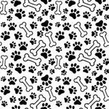 Seamless background - pet paw print and bone Royalty Free Stock Photos