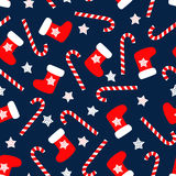 Seamless Christmas pattern with xmas socks, stars and candy canes. Royalty Free Stock Image