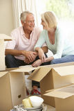 Senior Couple Moving Home And Packing Boxes Stock Photos
