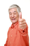 Senior Japanese man with thumbs up gesture Royalty Free Stock Photo