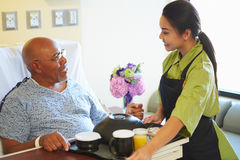 Senior Male Patient Being Served Meal In Hospital Bed Royalty Free Stock Photos