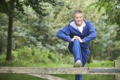 Senior Man Stretching On Countryside Run Stock Photo