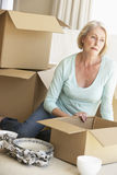 Senior Woman Moving Home And Packing Boxes Stock Images