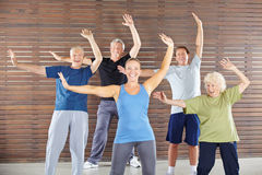 Seniors dancing and exercising in gym Royalty Free Stock Photography