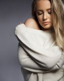Sensual sexy model in oversized sweater Stock Image