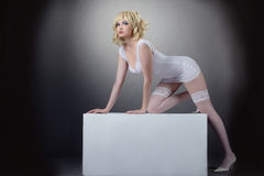 Sensuality potrait of pretty woman with cube Royalty Free Stock Image