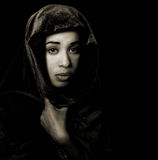 Serene African American woman wearing a shawl in monochrome Royalty Free Stock Photos