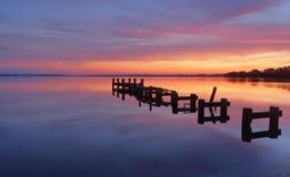Serene water and stunning sunrise at Gorokan Jetty Australia Stock Photography