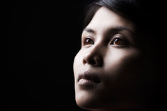 Serene woman in dark Stock Image