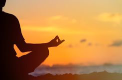 Serenity and yoga practicing at sunset Royalty Free Stock Photography