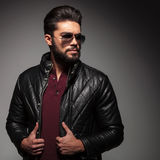 Serious bad boy wearing in jacket and sunglasses looking away Stock Photos