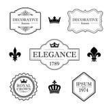 Set of calligraphic flourish design elements - fleur de lis, crowns, frames and borders - decorative vintage style Royalty Free Stock Images