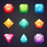 Set of cartoon colored stones with different signs element for use in the game, three in a row Stock Photo