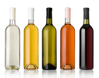 Set of white, rose, and red wine bottles. Royalty Free Stock Photo