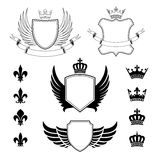 Set of winged shields - coat of arms - heraldic design elements, fleur de lis and royal crowns Royalty Free Stock Photography