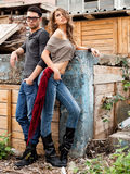 Sexy fashionable couple wearing jeans posing dramatic Stock Images