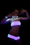 Sexy girl with glow make-up in ultraviolet light Stock Photography