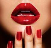 Sexy Lips and Nails closeup Royalty Free Stock Image