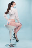 Sexy Nurse in Shirt and Panties Sitting on a Stool Stock Images