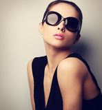 Sexy perfect female model posing in fashion sun glasses. Vintage Stock Images