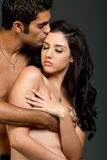Sexy young ethnic couple Stock Images