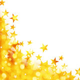 Shiny background of golden lights with stars Stock Images