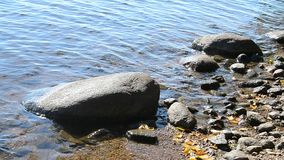 Shores of a lake with rock. stock video footage
