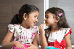 Sibling eating foods Stock Images