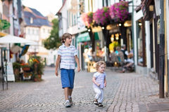 The siblings in a historical city centre Stock Photography