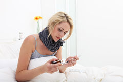 Sick woman taking a dose of medicine Royalty Free Stock Image
