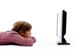Side pose of boy watching tv Royalty Free Stock Photo