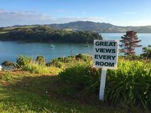Sign promoting tourism in Mangonui Harbour, Northland, New Zealand Royalty Free Stock Photography