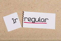 Sign with word irregular turned into regular Royalty Free Stock Image