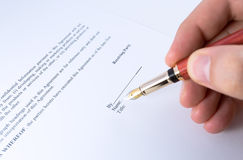 Signing Non disclosure agreement Stock Images