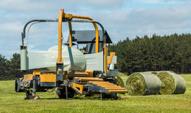 Silage Round Bale Wrapper Royalty Free Stock Photo