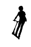 Silhouette of a boy with his scooter Royalty Free Stock Image