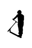 Silhouette of a boy with his scooter Royalty Free Stock Photo